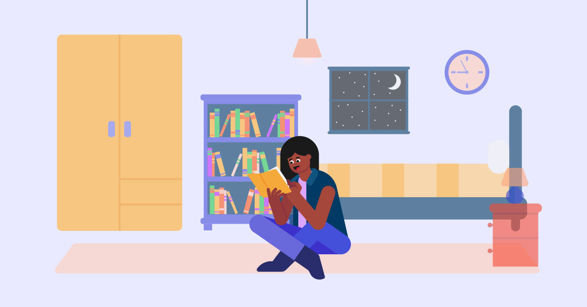 Girl sitting and reading in her room